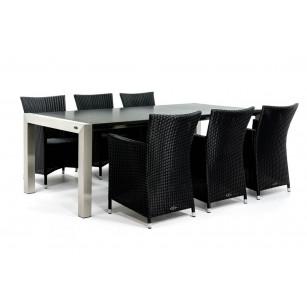 Moderner Gartentisch mit Tischplatte aus Granit und Rattanstühlen